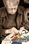 Carol HIll sewing her quilt square by Sally Wiener Grotta